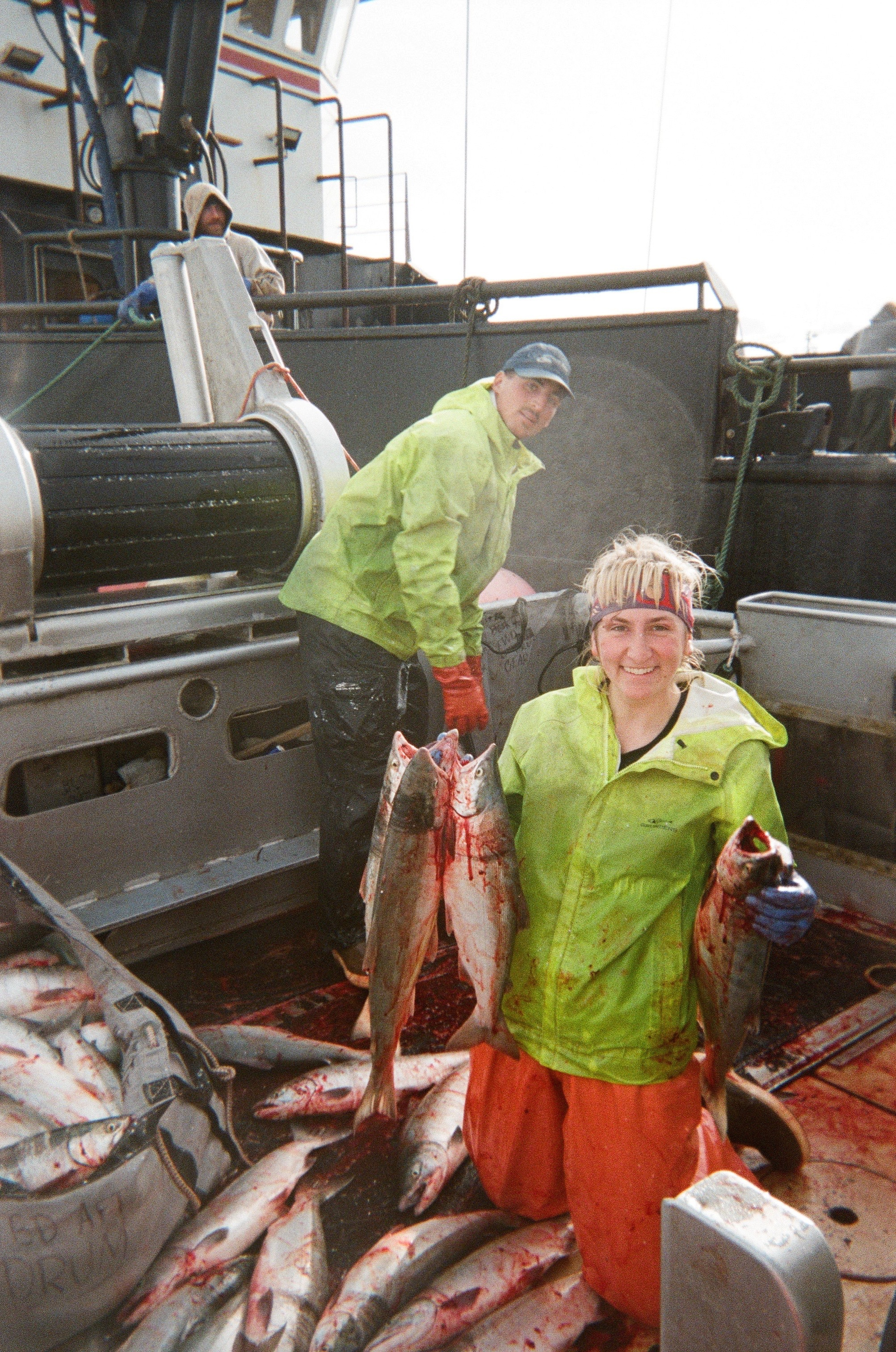 Sophie holding salmon during a deck load day. (Photo courtesy of Sophie Marinkovich)